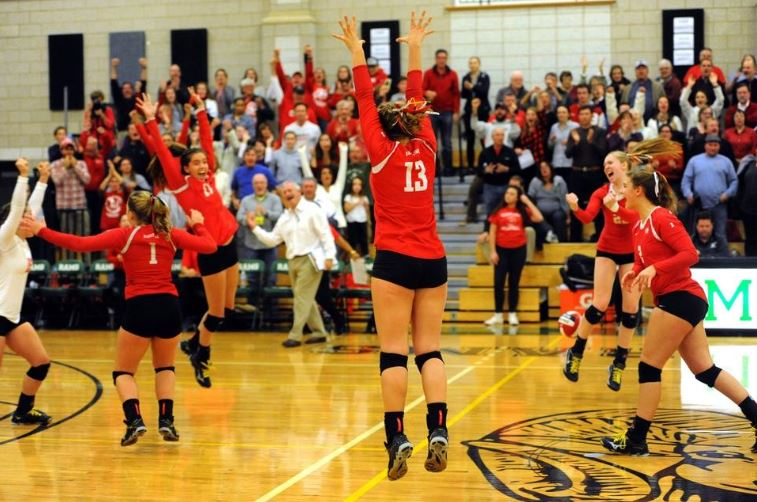 Barnstable players react after winning Division I South Sectional Title in Volleyball
